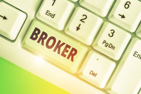 Conceptual hand writing showing Broker. Concept meaning serves as a trusted agent or intermediary in commercial negotiations