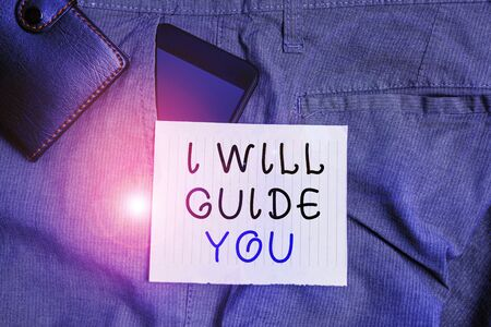 Conceptual hand writing showing I Will Guide You. Concept meaning Help showing a route Influence to do or think something Smartphone device inside trousers front pocket with wallet Фото со стока
