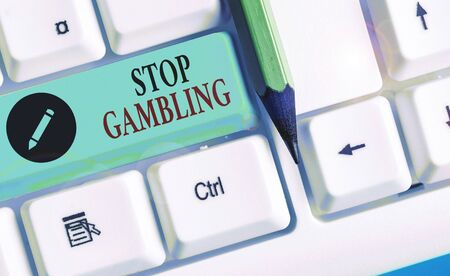 Writing note showing Stop Gambling. Business concept for stop the urge to gamble continuously despite harmful costs