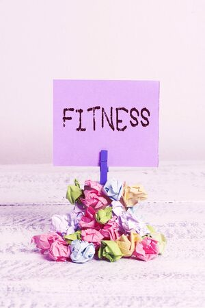 Word writing text Fitness. Business photo showcasing the state of health and wellbeing and the ability to perform Reminder pile colored crumpled paper clothespin reminder white wooden space Banco de Imagens