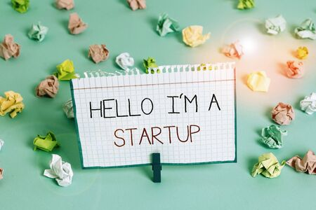 Handwriting text Hello I am A Startup. Conceptual photo Entrepreneur starting business Presenting New project Colored crumpled papers empty reminder blue floor background clothespin