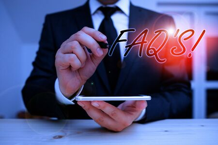 Text sign showing Faq. Business photo showcasing a list of questions and answers relating to a particular subject Male human wear formal clothes present presentation use hi tech smartphone