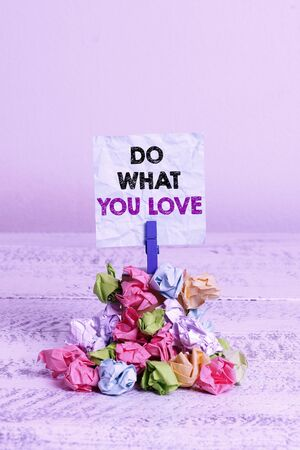 Handwriting text Do What You Love. Conceptual photo Make enjoyable things do activities with motivation Reminder pile colored crumpled paper clothespin reminder white wooden space