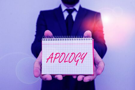Word writing text Apology. Business photo showcasing a written or spoken expression of one s is regret remorse or sorrow Male human wear formal work suit office look hold mathematics book use hand Stock Photo