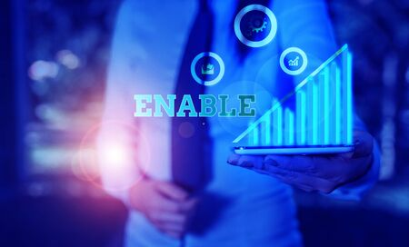 Writing note showing Enable. Business concept for give someone or something the authority or means to do something Banque d'images