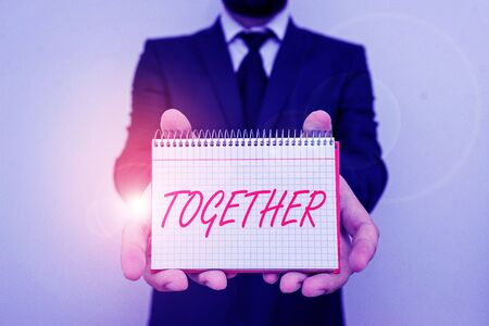 Word writing text Together. Business photo showcasing A close and harmonious relationship in which the showing or groups Male human wear formal work suit office look hold mathematics book use hand