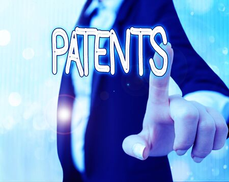 Text sign showing Patents. Business photo text government authority or licence conferring a right or title Standard-Bild