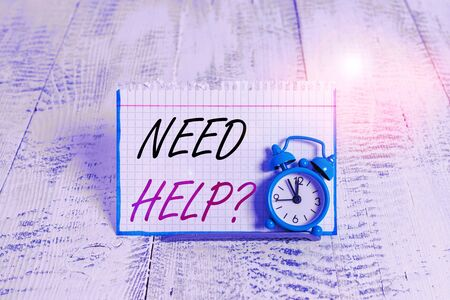 Word writing text Need Helpquestion. Business photo showcasing to give or provide what is necessary to accomplish a task Mini blue alarm clock stand tilted above buffer wire in front of notepaper