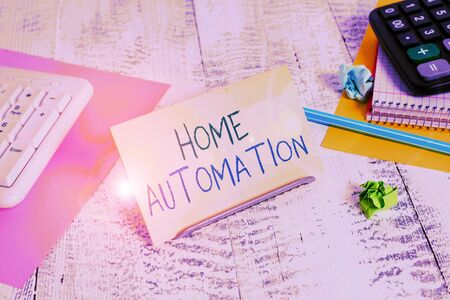 Conceptual hand writing showing Home Automation. Concept meaning home solution that enables automating the bulk of electronic Notepaper on buffer wire in between keyboard and math sheets Standard-Bild
