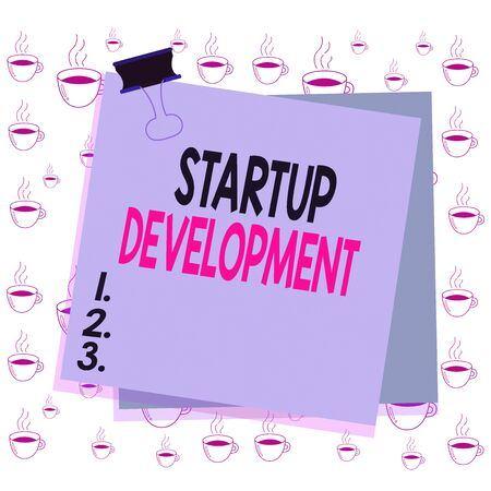 Writing note showing Startup Development. Business concept for efficiently develop and validate scalable business model Paper stuck binder clip colorful background reminder memo office supply