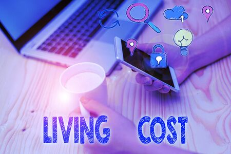 Writing note showing Living Cost. Business concept for the amount of money that a demonstrating needs to sustain life