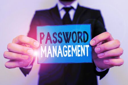 Writing note showing Password Management. Business concept for software used to help users better analysisage passwords Male human wear formal work suit with office look hold book