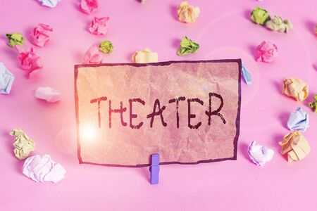Handwriting text writing Theater. Conceptual photo building or outdoor area in which plays and dramatic perforanalysisces Colored crumpled papers empty reminder pink floor background clothespin Stock fotó