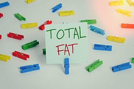 Text sign showing Total Fat. Business photo showcasing combined value of the different types of fat shown at the label Colored clothespin papers empty reminder white floor background office