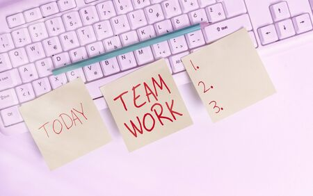 Text sign showing Team Work. Business photo showcasing Combined action of a group Workgroup cooperation collaboration Three empty green square papers and pencil by the pc keyboard with copy space