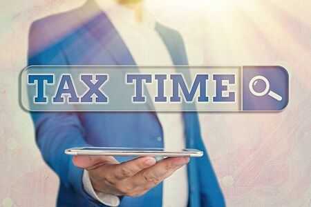 Text sign showing Tax Time. Business photo showcasing compulsory contribution state revenue levied government on workers Stock Photo