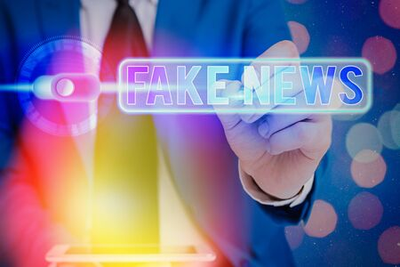 Writing note showing Fake News. Business concept for false information publish under the guise of being authentic news
