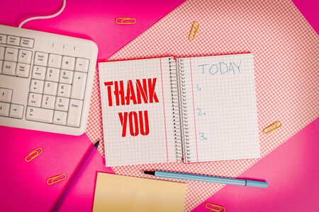 Conceptual hand writing showing Thank You. Concept meaning replaying on something good or greetings with pleased way Writing equipments and computer stuff placed on plain table