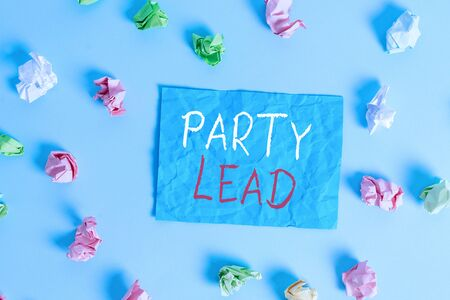 Writing note showing Party Lead. Business concept for acts as the official representative of their political party Colored crumpled rectangle shaped reminder paper light blue background Banque d'images