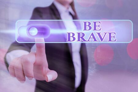 Conceptual hand writing showing Be Brave. Concept meaning ready to face and endure danger or pain showing courage Bold Stock Photo