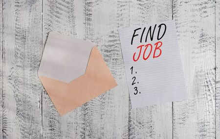 Handwriting text Find Job. Conceptual photo An act of demonstrating to find or search work suited for his profession Front view open colored envelope blank sheet letter paper wooden background