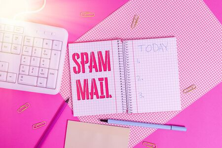 Conceptual hand writing showing Spam Mail. Concept meaning Intrusive advertising Inappropriate messages sent on the Internet Writing equipments and computer stuff placed on plain table