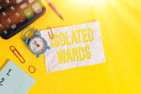 Text sign showing Isolated Wards. Business photo text far away from places or showing and having minimal contact Alarm clock clips note rubber band calculator pencil colored background