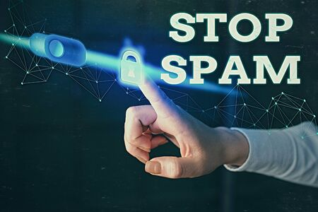 Writing note showing Stop Spam. Business concept for end the Intrusive or Inappropriate messages sent on the Internet Banco de Imagens