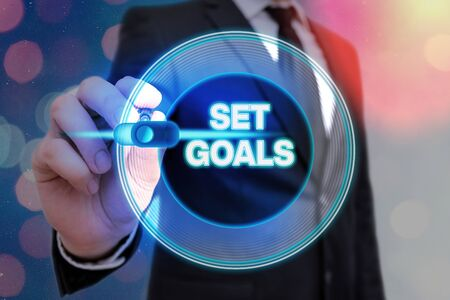 Writing note showing Set Goals. Business concept for Defining or achieving something in the future based on plan