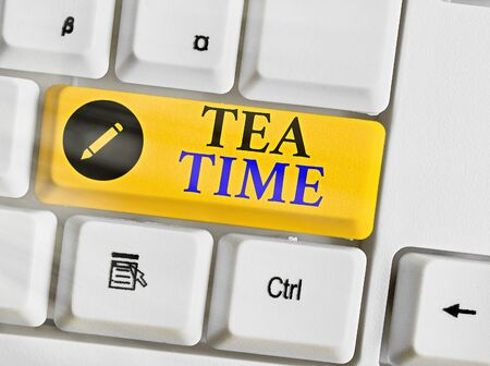 Conceptual hand writing showing Tea Time. Concept meaning the time in the afternoon when some showing eat a small meal Stock Photo