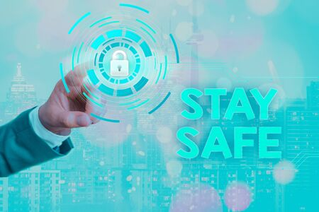 Writing note showing Stay Safe. Business concept for secure from threat of danger, harm or place to keep articles