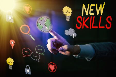 Writing note showing New Skills. Business concept for Recently Acquired Learned Abilities Knowledge Competences