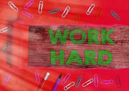 Text sign showing Work Hard. Business photo text Laboring that puts effort into doing and completing tasks Stock Photo