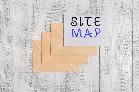 Handwriting text Site Map. Conceptual photo designed to help both users and search engines navigate the site Three envelopes around ruled paper sheet old wooden vintage background