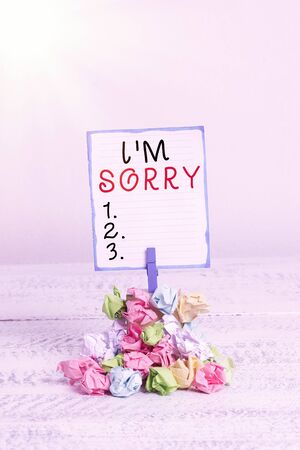 Handwriting text I M Sorry. Conceptual photo To ask for forgiveness to someone you unintensionaly hurt Reminder pile colored crumpled paper clothespin reminder white wooden space