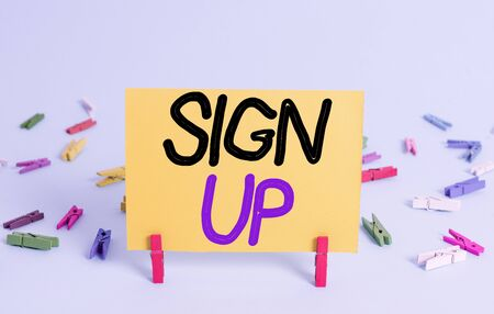 Conceptual hand writing showing Sign Up. Concept meaning use your information to register in website team college or blog Colored clothespin rectangle shaped paper blue background