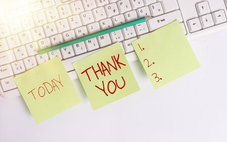 Text sign showing Thank You. Business photo showcasing replaying on something good or greetings with pleased way Three empty green square papers and pencil by the pc keyboard with copy space