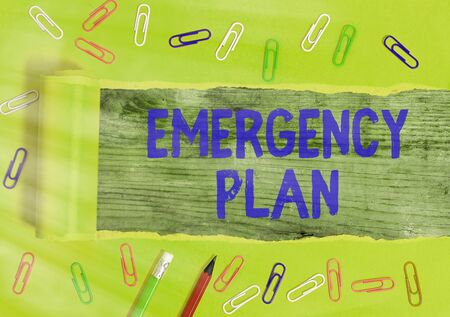 Writing note showing Emergency Plan. Business concept for instructions that outlines what workers should do in danger