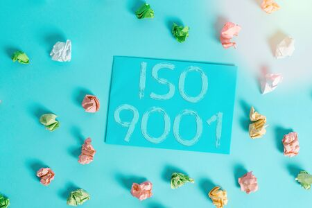 Conceptual hand writing showing Iso 9001. Concept meaning designed help organizations to ensure meet the needs of customers Colored clothespin rectangle shaped paper blue background