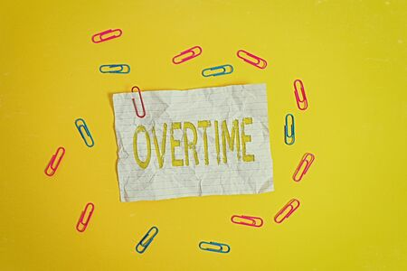 Handwriting text Overtime. Conceptual photo Time or hours worked in addition to regular working hours Blank crushed paper sheet message clips binders plain colored background