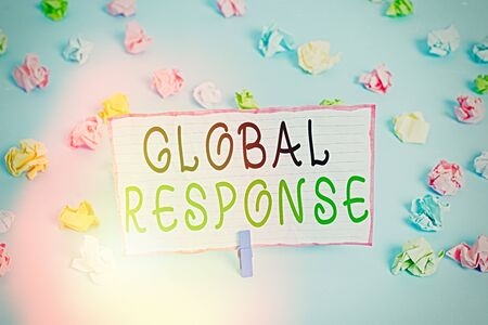 Conceptual hand writing showing Global Response. Concept meaning indicates the behaviour of material away from impact point Colored crumpled papers empty reminder blue floor clothespin