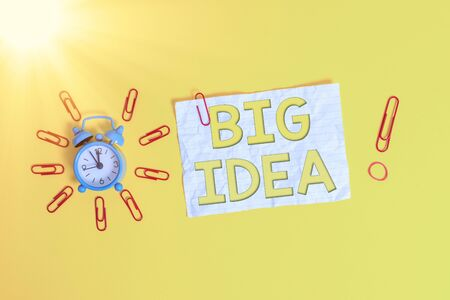 Word writing text Big Idea. Business photo showcasing Having great creative innovation solution or way of thinking Metal vintage alarm clips crushed sheet rubber band colored background Stockfoto