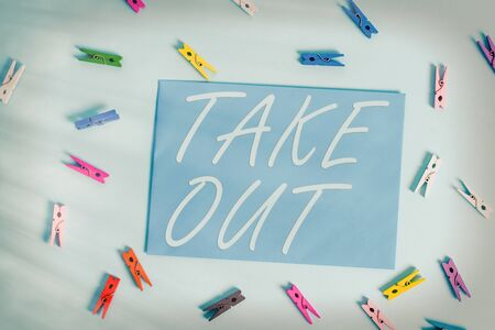 Text sign showing Take Out. Business photo showcasing the act of taking out food food from the restaurant to eat outside Colored clothespin rectangle shaped reminder paper light blue background