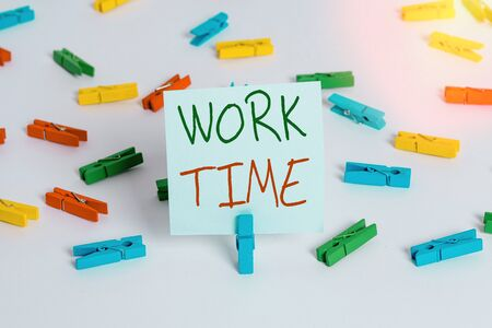 Text sign showing Work Time. Business photo showcasing period starts when temporary workers are engaged at a worksite Colored clothespin papers empty reminder white floor background office