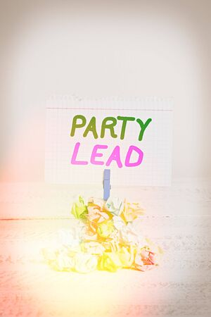 Text sign showing Party Lead. Business photo text acts as the official representative of their political party Reminder pile colored crumpled paper clothespin reminder white wooden space