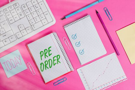 Conceptual hand writing showing Pre Order. Concept meaning an order for a product placed before it is available for purchase Writing equipments and computer stuff placed on plain table