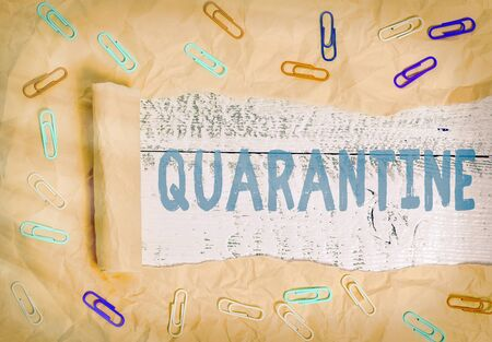 Conceptual hand writing showing Quarantine. Concept meaning restraint upon activities of individuals or transport of goods