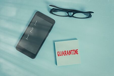 Word writing text Quarantine. Business photo showcasing restraint upon activities of individuals or transport of goods Dark eyeglasses colored sticky note smartphone fashion pastel background
