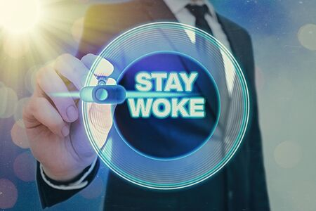 Writing note showing Stay Woke. Business concept for being aware of your surroundings and things going on Keep informed