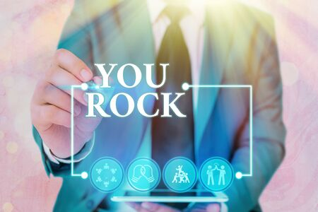 Handwriting text writing You Rock. Conceptual photo slang phrase of praise or encouragement conveying you are awesome Banco de Imagens